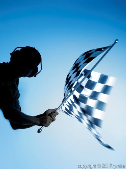 man waving checkered flag - model released