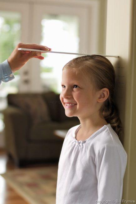 Parent Measuring Child